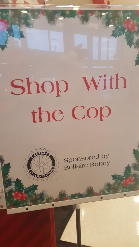 Shop with the cop sign - Sponsored by the Bellaire Rotary