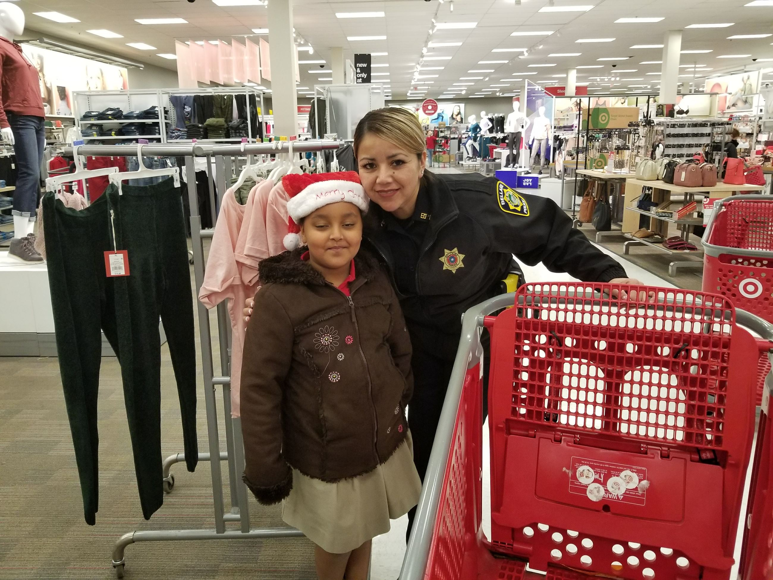 Girl and Officer stand together in clothing department