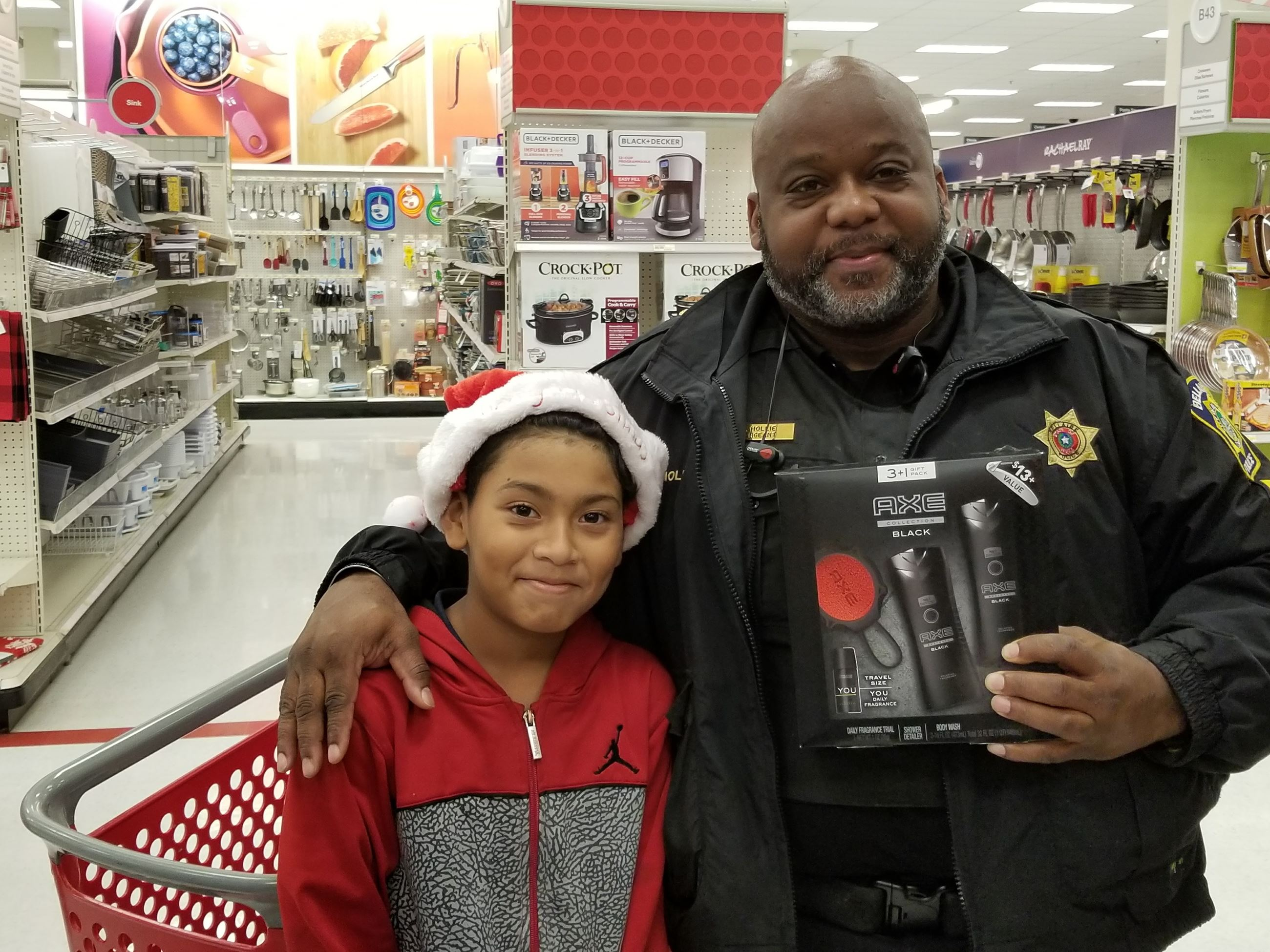 Police officer and child at Shop with a Cop event