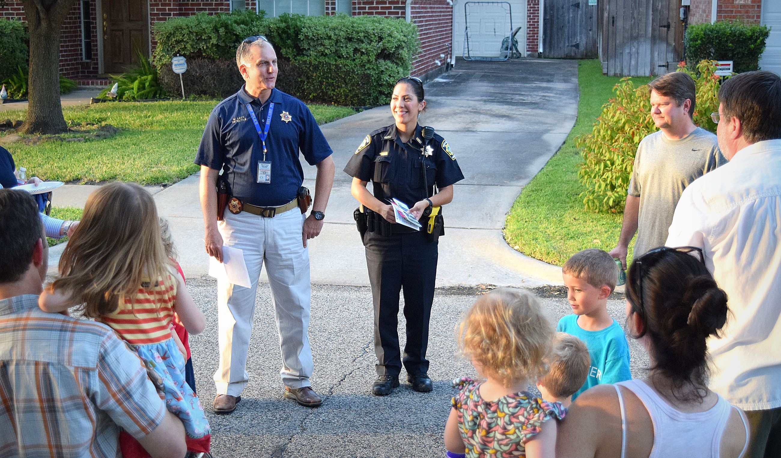 Police Department members speak to group at outdoor event